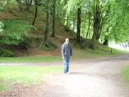 Tyler walking toward Dunkeld Cathedral