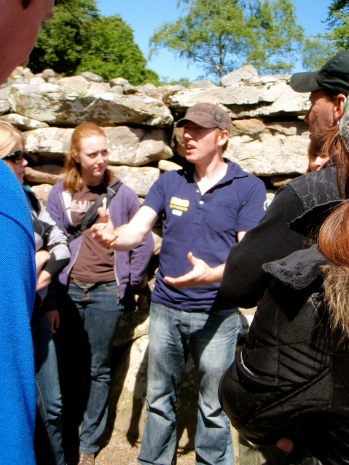 Our tour guide explaining the use of the Cairns