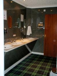 Bathroom with Scottish tartan carpet
