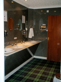 Bathroom with Scottish tartan carpet