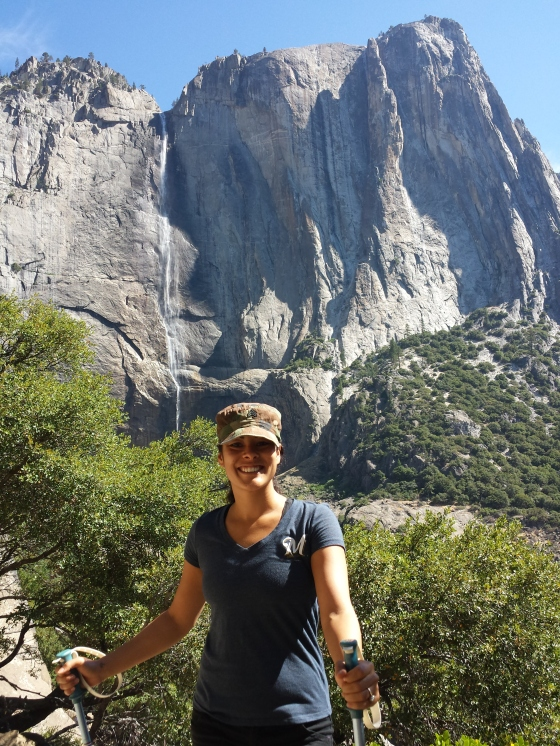 Mrs. Jessetter posing with Yosemite Falls