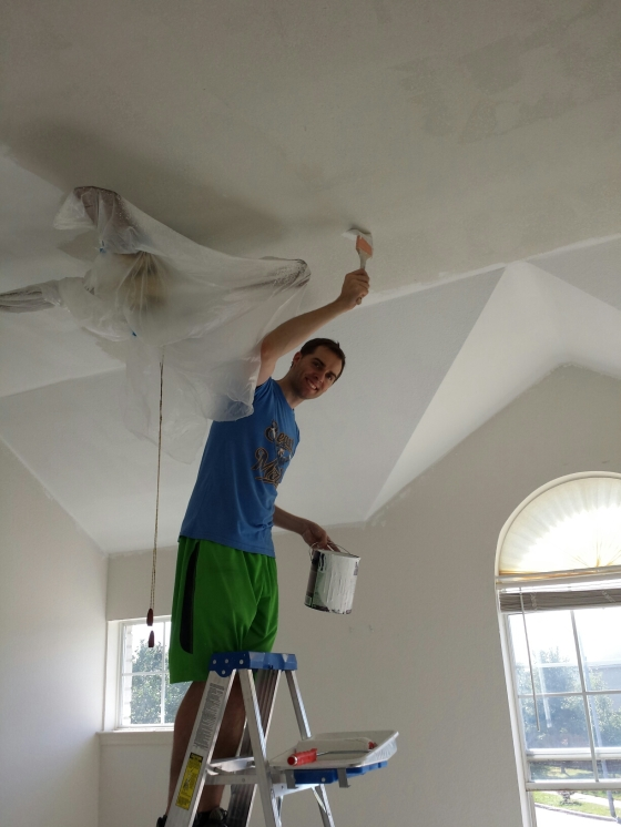 Tyler painting away at our ceilings!